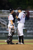 Kannapolis Intimidators catcher Casey Schroeder (17) has a chat on the mound with relief pitcher Lane Hobbs (26) during the game against the Hagerstown Suns at Kannapolis Intimidators Stadium on June 14, 2017 in Kannapolis, North Carolina.  The Intimidators defeated the Suns 10-1 in game two of a double-header.  (Brian Westerholt/Four Seam Images)