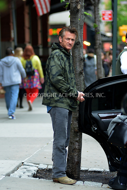 ACEPIXS.COM<br /> <br /> May 9 2014, New York City<br /> <br /> Actor Sean Penn leaves a downtown hotel with Charlize Theron's adpopted son Jackosn on May 9 2014 in New York City<br /> <br /> <br /> By Line: Curtis Means/ACE Pictures<br /> <br /> ACE Pictures, Inc.<br /> www.acepixs.com<br /> Email: info@acepixs.com<br /> Tel: 646 769 0430