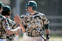 Slippery Rock infielder Will Kengor (32) after scoring a run during a game against Upper Iowa University at Frank Tack Field on March 14, 2014 in Clearwater, Florida.  Slippery Rock defeated Upper Iowa 14-9.  (Mike Janes/Four Seam Images)