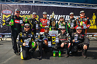 Sep 17, 2017; Concord, NC, USA; NHRA top fuel drivers (front row from left) Shawn Langdon , Antron Brown , Steve Torrence , Scott Palmer (back row) Terry McMillen , Tony Schumacher , Leah Pritchett , Brittany Force , Clay Millican and Doug Kalitta pose for a group photo as the drivers in the Countdown to the Championship during the Carolina Nationals at zMax Dragway. Mandatory Credit: Mark J. Rebilas-USA TODAY Sports