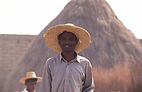 Yemen,portrait of shepherd with a typical straw hat at the sheep market