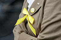 "Pictured: A yellow ribbon and a badge worn in tribute to Bradley John by a mourner at Aberavon Beach Hotel, Wales, UK. Monday 08 October 218<br /> Re: A grieving father will mourners on horseback at the funeral of his ""wonderful"" son who killed himself after being bullied at school.<br /> Talented young horse rider Bradley John, 14, was found hanged in the school toilets by his younger sister Danielle.<br /> Their father, farmer Byron John, 53, asked the local riding community to wear their smart hunting gear at Bradley's funeral.<br /> Police are investigating Bradley's death at the 500-pupils St John Lloyd Roman Catholic school in Llanelli, South Wales.<br /> Bradley's family claim he had been bullied for two years after being diagnosed with Attention Deficit Hyperactivity Disorder.<br /> He went missing during lessons and was found in the toilet cubicle by his sister Danielle, 12."