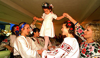 At a Ukranian Easter Celebration Adriana Fedoryczak, 4 walks on a groups hands during a dance ceremony.