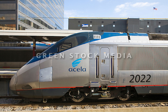 A close-up of Acela Express electric power car at Boston South Station. Amtrak Acela Express is a high speed tilting train which travels along the East Coast of the United States from Boston, Massachusetts to Washington, DC. Boston, Massachusetts, USA