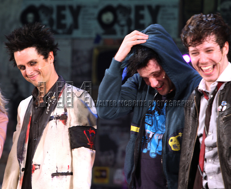 """Billie Joe Armstrong with John Gallagher Jr, Michael Esper & ensemble cast during the curtain call as he makes his Broadway Debut As """"St. Jimmy"""" in """"American Idiot"""" at the St. James Theatre in New York City.  September 28, 2010.© Walter McBride /"""
