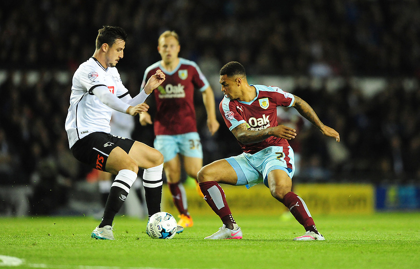 Burnley&rsquo;s Andre Gray vies for possession with Derby County's George Thorne<br /> <br /> Photographer Chris Vaughan/CameraSport<br /> <br /> Football - The Football League Sky Bet Championship - Derby County v Burnley - Monday 21st September 2015 - iPro Stadium - Derby<br /> <br /> &copy; CameraSport - 43 Linden Ave. Countesthorpe. Leicester. England. LE8 5PG - Tel: +44 (0) 116 277 4147 - admin@camerasport.com - www.camerasport.com