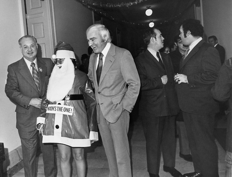 Congressmen and staff member in Santa's outfit at a Christmas party. (Photo by Dev O'Neill/CQ Roll Call via Getty Images)