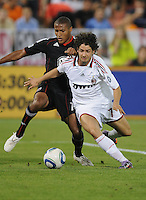 AC Milan forward Alexander Pato (7) shields the ball against DC United defender Jordan Graye (16)  DC United defeated AC. Milan 3-2 at RFK Stadium, Wednesday May 26, 2010.