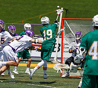 Vermont's Braiden Davis (#19) shoots as UAlbany Lacrosse defeats Vermont 14-4  in the American East Conference Championship game at Casey Stadium, May 5.