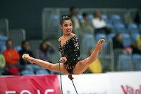 Lisa Wang of USA straddle leaps with rope at 2008 Portimao World Cup of Rhythmic Gymnastics on April 18, 2008.  (Photo by Tom Theobald).