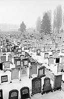 ROMANIA, Bucharest,  2002..Cemetery in Bucharest, Giurgiu Bd. 900,000 Jews lived in Romania before the war. They are now less than 12,000 in  Romania and 6000 in Bucharest. Only cemeteries seem to keep the memory of the 3rd European Jewry..ROUMANIE, Bucarest, 2002..Cimetière de Bucarest, Bd. Giurgiu. 900000 Juifs vivaient en Roumanie avant la guerre. Ils sont aujourd'hui moins de 12000 en Roumanie dont 6000 à Bucarest. Seuls les cimetières semblent garder la mémoire de la 3ème communauté juive d'Europe..© Bruno Cogez