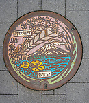 Manhole cover decorated art in Mt Fuji, Japan