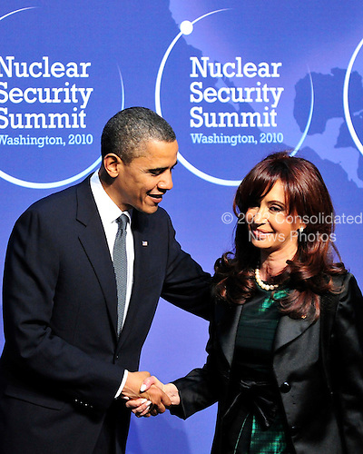 United States President Barack Obama welcomes President Cristina Fernández de Kirchner of Argentina to the Nuclear Security Summit at the Washington Convention Center, Monday, April 12, 2010 in Washington, DC. .Credit: Ron Sachs / Pool via CNP