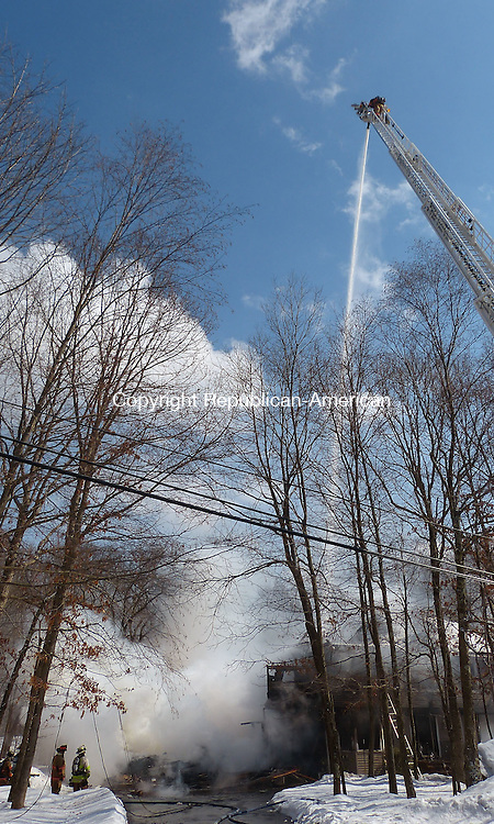 OXFORD, CT-26 February 2014-022614BF14-     A fire that started in a garage destroyed a house at 2 Scott Drive in Oxford on Wednesday.<br /> Fire departments from Oxford, Southbury, Beacon Falls and Seymour responded to the blaze at a home owned by Franklin B. Young Jr. and Susan L. Young.<br /> There were no injuries reported. The husband and wife who own the 3,000-square-foot building were home at the time of the fire. They escaped unharmed, along with their dog Smudge.  Bob Falcetti Republican-American