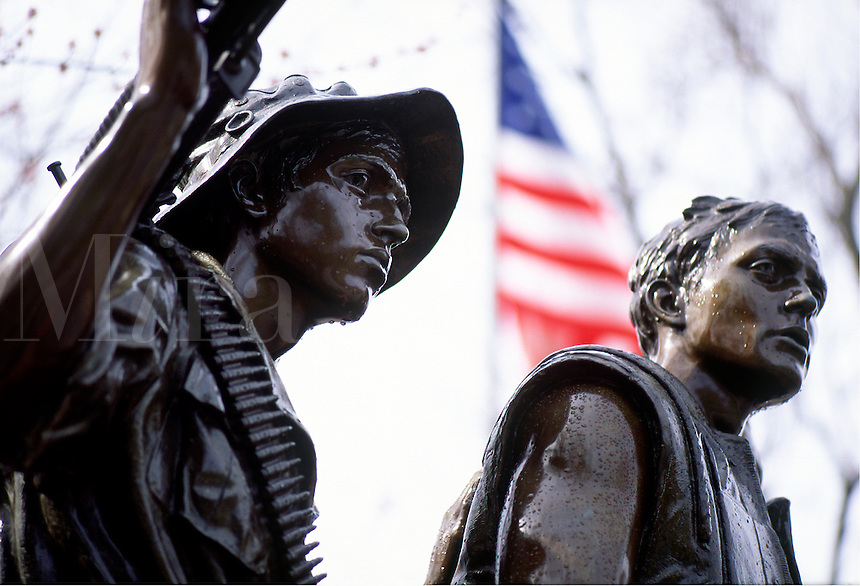 Alternative Vietnam Veterans War Memorial, with statue of soldiers , weapons, American flag, detail #5412. Washington DC.