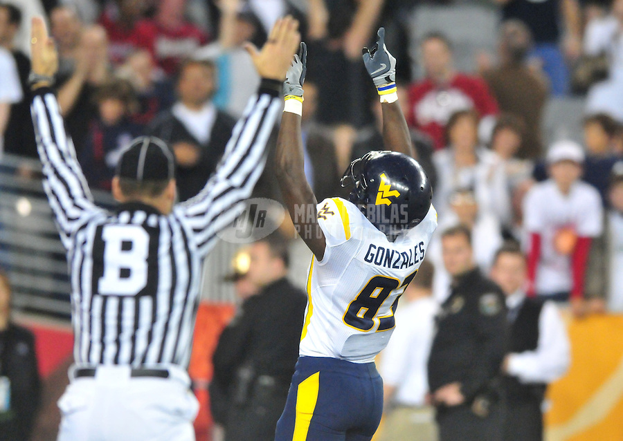 Jan 2, 2008; Glendale, AZ, USA; West Virginia Mountaineers wide receiver Tito Gonzales (83) celebrates after catching a pass for a fourth quarter touchdown against the Oklahoma Sooners during the Fiesta Bowl at University of Phoenix Stadium. West Virginia defeated Oklahoma 48-28. Mandatory Credit: Mark J. Rebilas-US PRESSWIRE