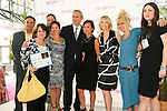 Andrea Goldsmith, Jean-Luc Teinturier, Josie Natori, Carole Hochman, Betsey Johnson, and others on stage at the CURVE and CFDA Party For A Cause event during the CURVENY Lingerie & Swim show, at the Jacob Javits Convention Center, August 2, 2010.