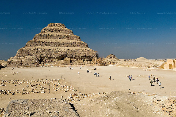 Saqqara, Cairo, Egypt -- Part of what was once a magnificant complex, the famous step pyramid of Djoser (Dozer) stands before a large courtyard arena and surrounded by the remains of the many buildings that originally bounded its precincts. © Rick Collier / RickCollier.com