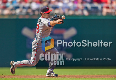 8 June 2013: Minnesota Twins utilityman Jamey Carroll initiates a double play against the Washington Nationals at Nationals Park in Washington, DC. The Twins edged out the Nationals 4-3 in 11 innings. Mandatory Credit: Ed Wolfstein Photo *** RAW (NEF) Image File Available ***