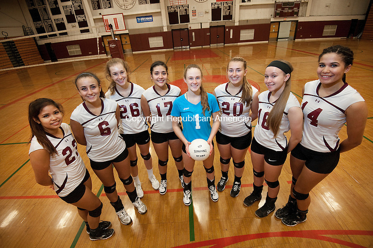 TORRINGTON,  CT-111716JS05-  Torrington volleyball starters, from left, Gabriella Ballesteros; Carissa Carbone; Nina Lestrud; Jayleen Colon; Candyce Jewett; Ali Dubois; Lauren Gaghan and Jolie Fox pose for a photo following practice Thursday at the school. Torrington will play Seymour in the Class M Finals on Saturday. <br /> Jim Shannon Republican American