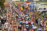 The peloton lined out on a cobbled sector at Thiméon during Stage 1 of the 2019 Tour de France running 194.5km from Brussels to Brussels, Belgium. 6th July 2019.<br /> Picture: ASO/Pauline Ballet | Cyclefile<br /> All photos usage must carry mandatory copyright credit (© Cyclefile | ASO/Pauline Ballet)