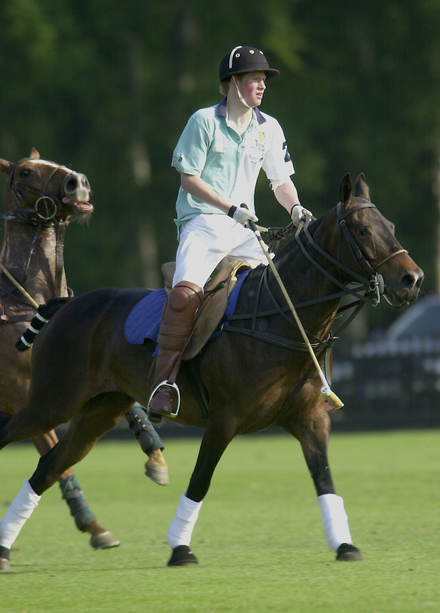 PRINCE HARRY DONS THE ETON College STRIP FOR THE LAST TIME AS HE FINISHES AT THE SCHOOL IN THE ETON VS. HARROW POLO MATCH AT THE GUARDS POLO CLUB GREAT WINDSOR PARK..PIC JAYNE RUSSELL.14.6.2003