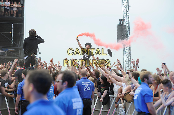Oliver Sykes of Bring Me The Horizon <br /> performing on the Main stage, Reading Festival, Reading, England, UK, 23rd August 2013.<br /> music concert gig live on stage half length red flare smoke <br /> CAP/MAR<br /> &copy; Martin Harris/Capital Pictures
