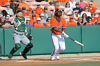 Clemson Tigers right fielder Chris Epps hits a homerun in his first at bat of the 2011 season as Kyle Peterson Catcher for the Eastern Michigan Eagles watches at Doug Kingsmore Stadium, Clemson, SC. Clemson won 14-3. Photo By Tony Farlow/Four Seam Images.