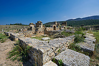 Picture of the ruins of the Byzantine Martyrion of St Philip church and healing centre. Hierapolis archaeological site near Pamukkale in Turkey.<br /> <br /> Martyrion of St Philip. This church with an octagonal core was built at the beginning of the 5th century on the summit of the hill. This is probably where, according to tradition, the Apostlie was martyred. The building has an eight-sided central room surmounted by a wooden cupola. From each of the eight sides of the central space there was access to a rectangular room through three arches supported by marble columns with capitals decorated with acanthus leaves The shape of the central room is a reference to the number eight which symbolists eternity. The church is situated inside a square composed of 28 rooms for housing pilgrims which were accessed from the outside. As in other Byzantine sanctuaries associated with heating powers (eg that of Saints Cosmas and Damian in Constantinople), in these rooms incubation rites were practised: during sleep, the Saint cured the sick and made prophecies concerning the future.