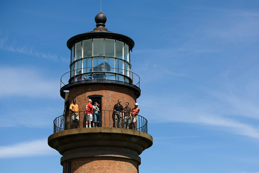 U.S. President Barack Obama (C, black shirt) and his family and friends tour Gay Head lighthouse in Aquinnah on Martha's Vineyard, August 27, 2009. The lighthouse first began operating in 1799...