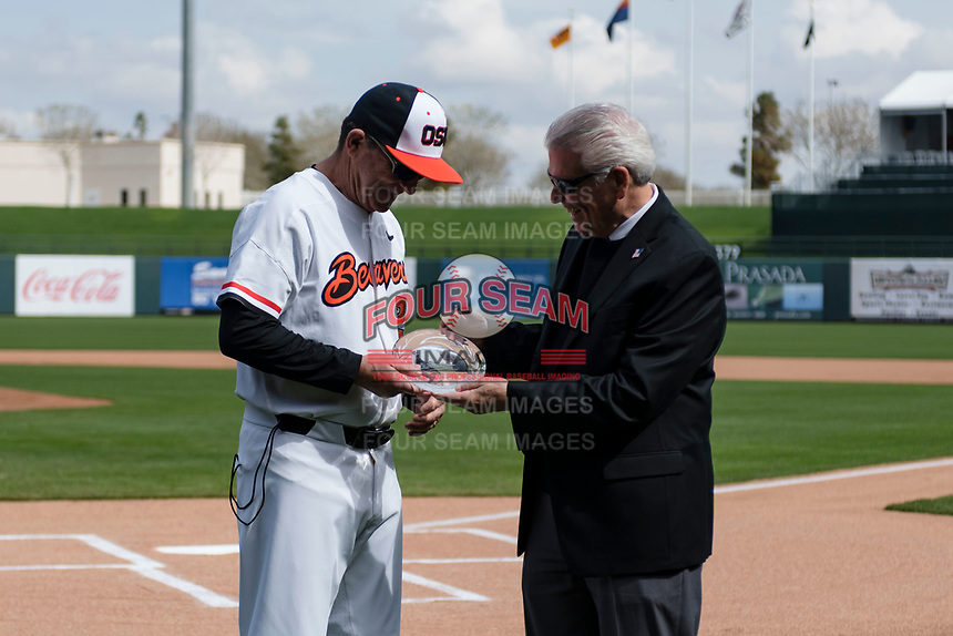 Oregon State Beavers interim head coach Pat Bailey receives an award before a game against the New Mexico Lobos on February 15, 2019 at Surprise Stadium in Surprise, Arizona. Oregon State defeated New Mexico 6-5. (Zachary Lucy/Four Seam Images)