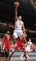 Virginia guard Malcolm Brogdon (15) shoots in front of North Carolina State defenders during the game Wednesday Jan. 7, 2015 in Charlottesville, Va. Virginia won 61-51.