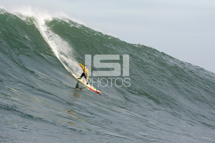 "Grant ""Twiggy"" Baker sticks this run at  Mavericks Surf Contest 2008.  Half Moon Bay, Ca.  January 12, 2008."