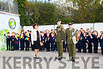 Defence Forces members Sergeant Chris Hoare, Killorglin originally and Gunner James Power, Waterford, get a Guard of honour by flag waving pupils of Listellick NS when they  deliver the   tricolour and Proclamation  to commemorate the 100 year anniversary here with Principal Annette Dineen on Monday