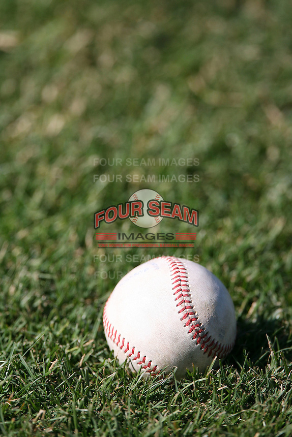 June 4th 2007:  A baseball sits in the grass before a game at Jerry Uht Park in Eria, PA.  Photo by Mike Janes/Four Seam Images
