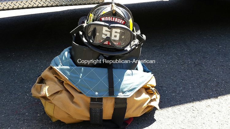 MIDDLEBURY, CT --- 19 Aug. 2014: 081914BB02 --- The late Thomas O. Proulx's helmet and firefighting gear is placed beside the town ambulance he drove to honor his service. Bill Bittar Republican-American
