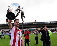 Lincoln City's Luke Waterfall holds aloft the Vanarama National League trophy<br /> <br /> Photographer Chris Vaughan/CameraSport<br /> <br /> Vanarama National League - Lincoln City v Macclesfield Town - Saturday 22nd April 2017 - Sincil Bank - Lincoln<br /> <br /> World Copyright &copy; 2017 CameraSport. All rights reserved. 43 Linden Ave. Countesthorpe. Leicester. England. LE8 5PG - Tel: +44 (0) 116 277 4147 - admin@camerasport.com - www.camerasport.com
