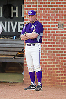 High Point Panthers head coach Craig Cozart (38) watches the action from just outside the dugout during the game against the Coastal Carolina Chanticleers at Willard Stadium on March 15, 2014 in High Point, North Carolina.  The Panthers defeated the Chanticleers 11-8 in game two of a double-header.  (Brian Westerholt/Four Seam Images)