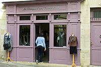 Customer enters ladies fashion shop Le Temps d'un Week-end in St Emilion, Bordeaux, France