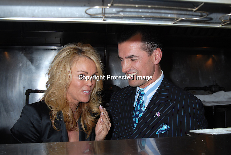 """Dina Lohan and Nino's owner Nino Selimaj..at Nino's Tuscany Restaurant party for Dina Lohan..and her cover of new magazine called """"Boulevard"""" on ..October 9, 2006. ..Robin Platzer, Twin Images"""