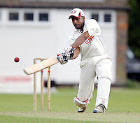Harmeet Singh bats for Harrow during the Middlesex County Cricket League Division Two game between Harrow St Mary's and Shepherds Bush at<br /> Harrow on Sat July 19, 2014