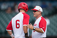 North Carolina State Wolfpack head coach Elliott Avent (9) gives instructions to Brett Kinneman (6) during the game against the Boston College Eagles in Game Two of the 2017 ACC Baseball Championship at Louisville Slugger Field on May 23, 2017 in Louisville, Kentucky.  The Wolfpack defeated the Eagles 6-1. (Brian Westerholt/Four Seam Images)