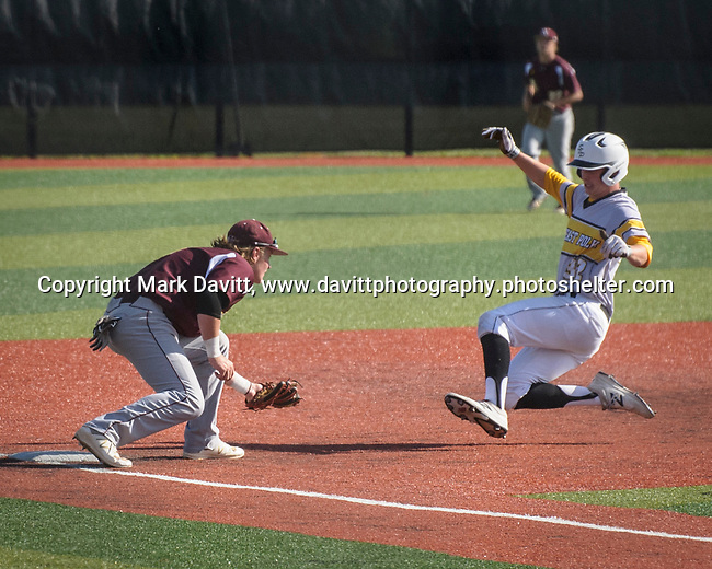 Southeast Polk and Ankeny met for a double header at SEP June 21. SEP prevailed twice, 2-0 and 8-1. AHS's Jayden Maifeld is ready for the tag on SEP's Chase Wheeldon.