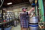 Full kegs being loaded onto wood pallets in the warehouse. Ninkasi is a regional craft brewery making beers in the Northwest style. Their location in Eugene, Oregon affords regional access for their primary ingredients, which include: Water, Malt, Hops and Yeast. With the strong regional hop industry, and access to the McKenzie River, source of some of the cleanest water in the world, Ninkasi is well positioned for their goal of brewing high quality craft beers. The beer's namesake, Ninkasi, was the Sumerian goddess of fermentation.
