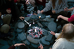 'Toasting marshmallows, 2019' from Colin McPherson's project 'Treasured Island' part of the Document Scotland exhibition entitled 'A Contested Land' which will launch at the Martin Parr Foundation, Bristol, on 16th January, 2019. McPherson's work was made in 2018-2019 on Easdale, the smallest permanently inhabited Inner Hebridean island and looks at the historical legacy of the island, once world famous for its slate mining industry.<br /> <br /> Photograph © Colin McPherson, 2019 all rights reserved.