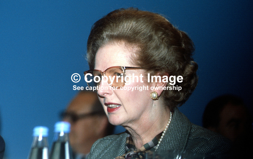 Margaret Thatcher, Prime Minister, UK, platform, annual conference, Conservative Party, Brighton, October, 1984, wearing glasses, following Provisional IRA bomb in the Grand Hotel, where the majority of Conservative Party VIPs were staying. 19840142MT1.<br /> <br /> Copyright Image from Victor Patterson, 54 Dorchester Park, Belfast, UK, BT9 6RJ<br /> <br /> t1: +44 28 9066 1296 (from Rep of Ireland 048 9066 1296)<br /> t2: +44 28 9002 2446 (from Rep of Ireland 048 9002 2446)<br /> m: +44 7802 353836<br /> <br /> victorpatterson@me.com<br /> www.victorpatterson.com<br /> <br /> Please see my Terms and Conditions of Use at victorpatterson.com . It is IMPORTANT that you familiarise yourself with them.<br /> <br /> Images used on the Internet incur an additional cost and must be visibly watermarked i.e. &copy;Victor Patterson within the body of the image and copyright metadata must not be deleted. Images used on the Internet have a size restriction of 4kbs and are chargeable at rates available at victorpatterson.com.<br /> <br /> This image is only available for the use of the download recipient i.e. television station, newspaper, magazine, book publisher, etc, and must not be passed on to any third party. It is also downloaded on condition that each and every usage is notified within 7 days to victorpatterson@me.com<br /> <br /> The right of Victor Patterson to be identified as the author is asserted in accordance with The Copyright Designs And Patents Act (1988). All moral rights are asserted.