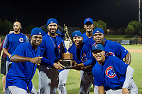 Alfredo Colorado (75), Emilio Ferrebus (43), Eugenio Palma (86), Ivan Medina (39), Jose Gutierrez (91), and Yonathan Perlaza (15) celebrate with the Chuck Jared Championship Cup after defeating the AZL Giants on September 7, 2017 at Scottsdale Stadium in Scottsdale, Arizona. AZL Cubs defeated the AZL Giants 13-3 to win the Arizona League Championship Series two games to one. (Zachary Lucy/Four Seam Images)
