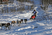 Saturday, February 24th, Knik, Alaska.  Jr. Iditarod musher Rebekah Ruzicka on the trail shortly after leaving the Knik start