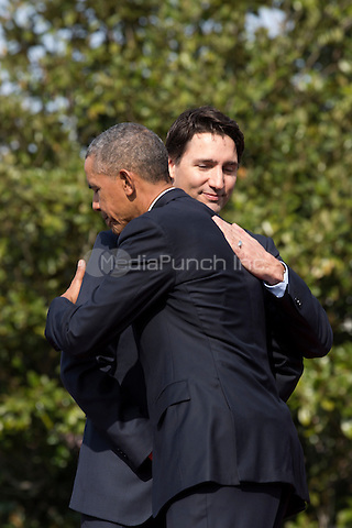 U.S. President Barack Obama hugs Prime Minister of Canada Justin Trudeau at an arrival ceremony on the South Lawn of the White House, in Washington, DC, USA, 10 March 2016. This is the first official visit of Prime Minister of Canada Justin Trudeau to the White House. <br /> Credit: Jim LoScalzo / Pool via CNP/MediaPunch