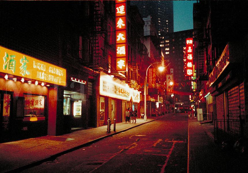 Chinatown street at night, New York City July, 1997. New York City NY USA China Town, Manhattan.